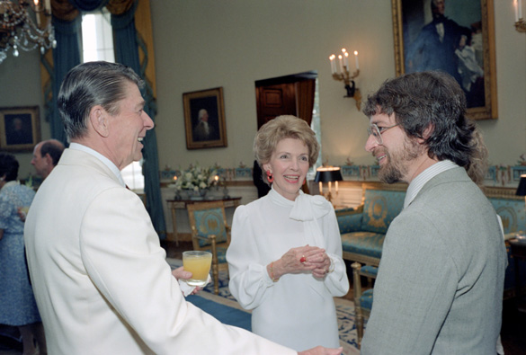Steven Speilberg talking with Ronald and Nancy Reagan at the ET: The Extraterrestrial Screening event. (Credit: Ronald Reagan Presidential Library)