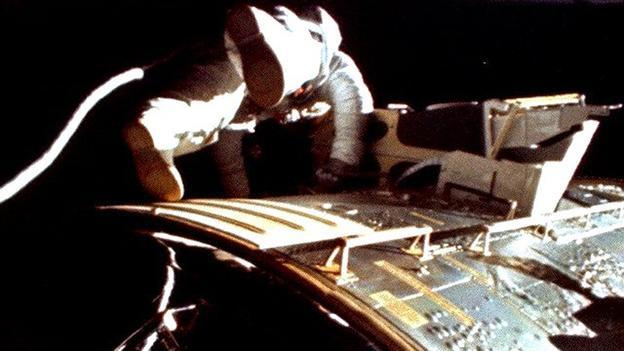 Out and about On the way back to Earth, Worden completed a space walk to retrieve film from cameras on the module. This shot was taken by Jim Irwin. (Copyright: Nasa)