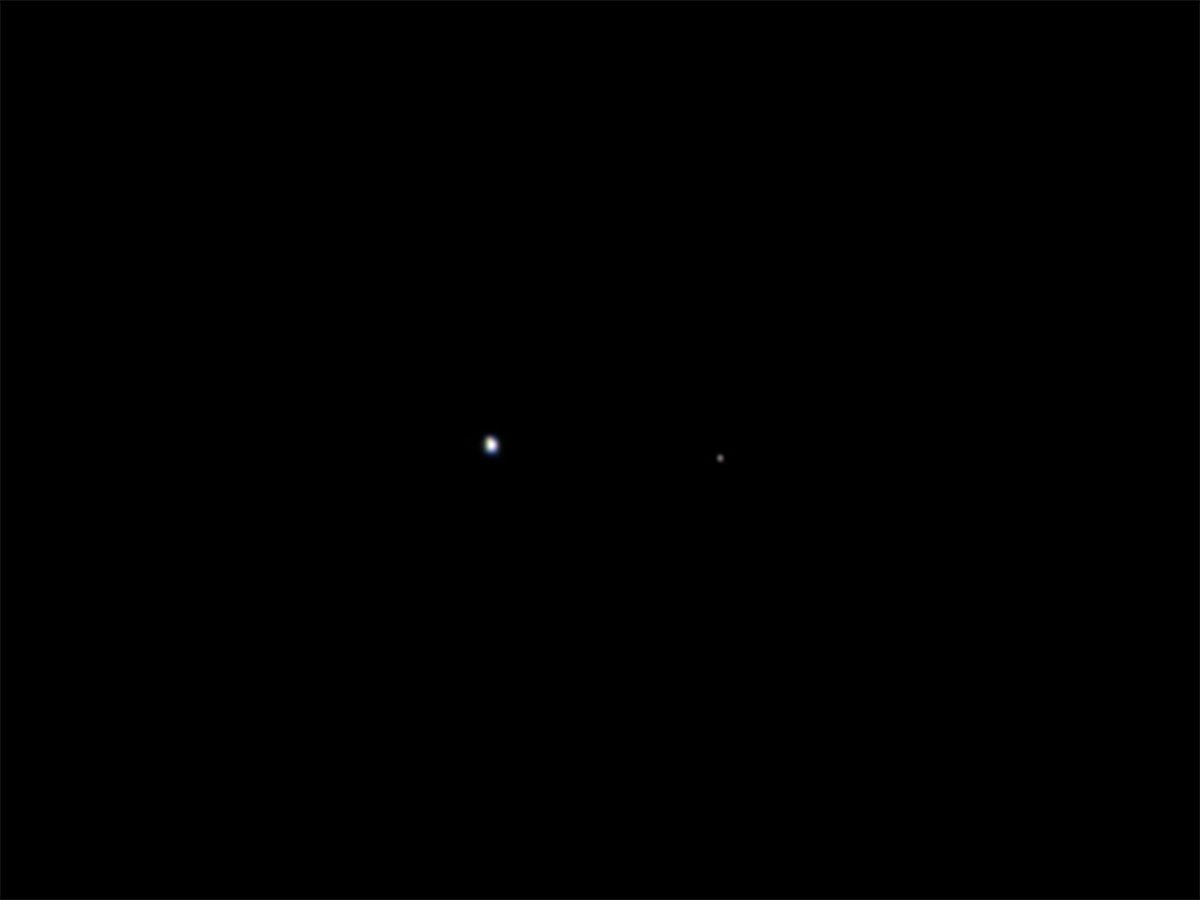 Even when paired together, the Earth-moon system looks insignificant from deep space.