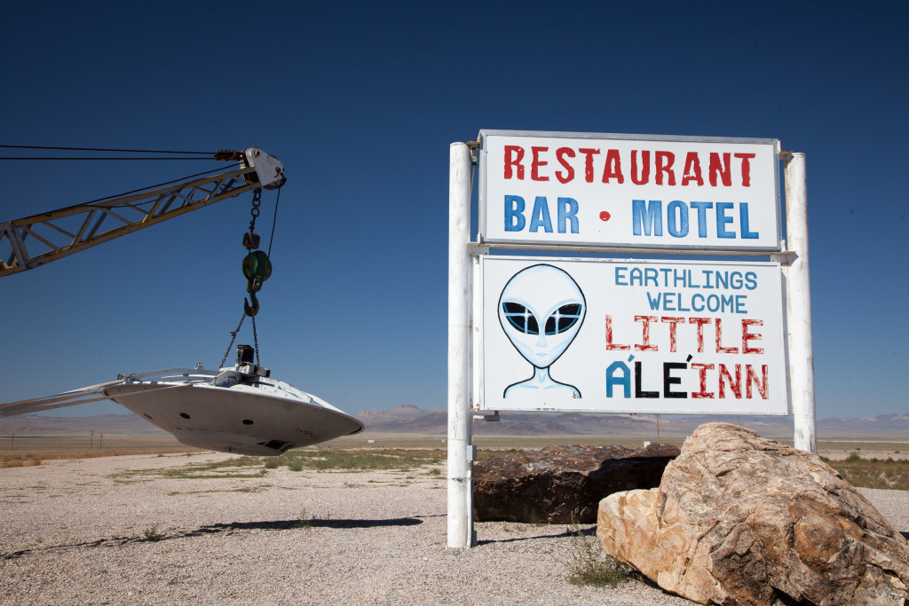 Sign for Little A'Le'Inn and flying saucer near Area 51. (Getty Images)